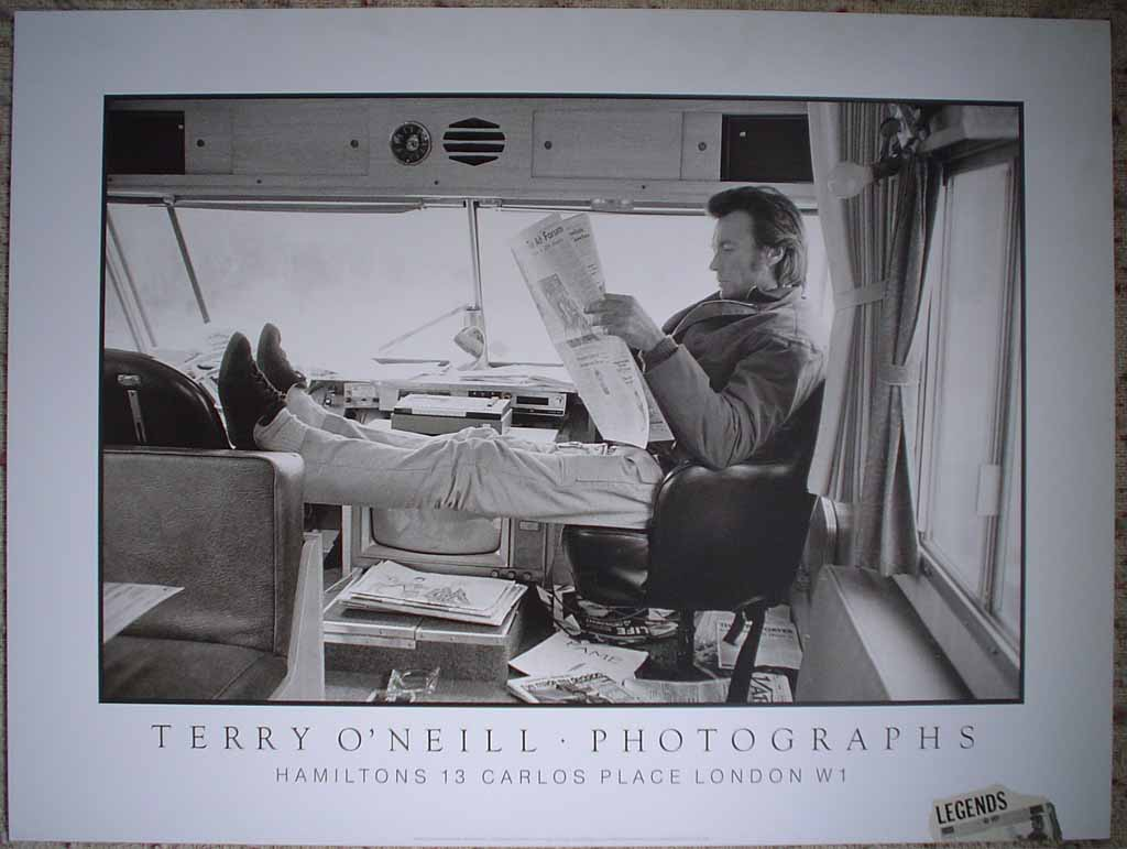 Clint Eastwood Joe Kidd by Terry O'Neill, shown with full margins - offset lithograph reproduction vintage poster print, from an original photograph by Terry O'Neill of Clint Eastwood relaxing during filming of Joe Kidd